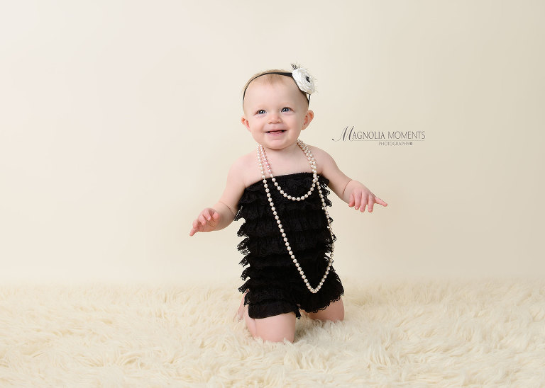 One year old baby girl all dressed up for her 1st birthday photography session taken by Evan Pollock a baby and child photographer in Collegeville PA.