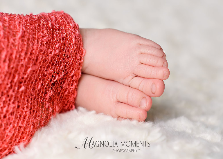 Newborn baby pic - a closeup of newborn baby's feet taken during her newborn photography session at Magnolia Moments Photography one of the photography studios near me - Collegeville newborn photography