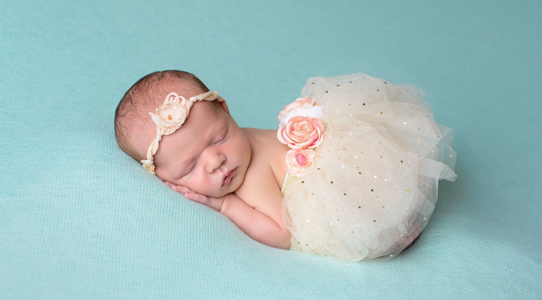 Newborn Baby Girl in white tutu professional photographer taken at Magnolia Moments Newborn studio in Collegeville PA by Evan Pollock professional photographer near me